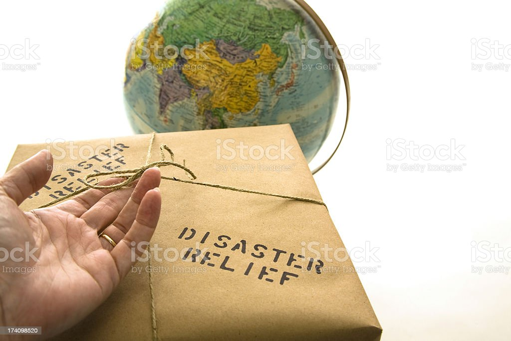 Disaster relief package. Globe background. stock photo