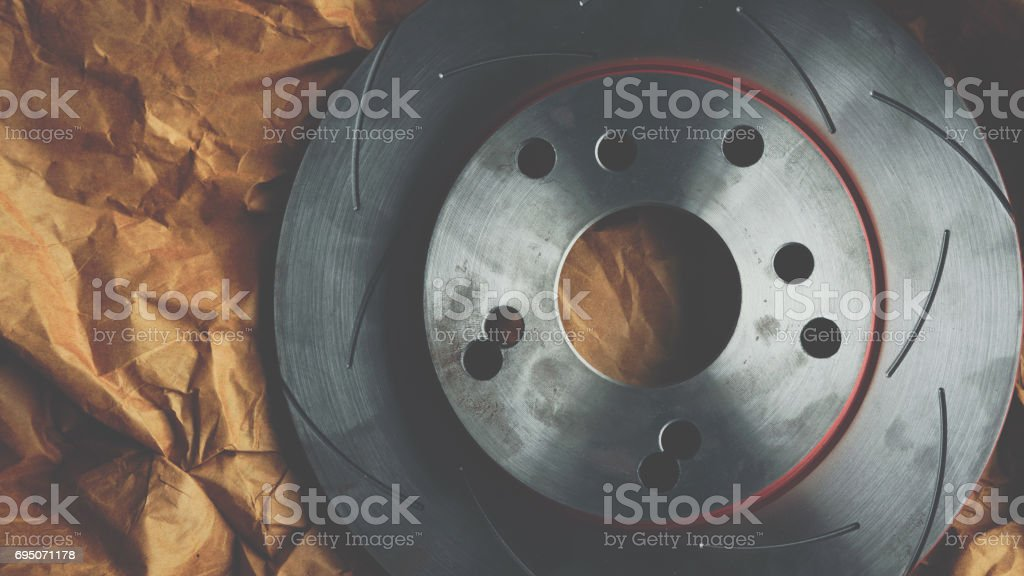 Disc brake 4/100 PDC. 4H. adapt to 5/114.3 PDC. 5H. it's a part of car use for stop the car this a spare part for repair at car garage stock photo