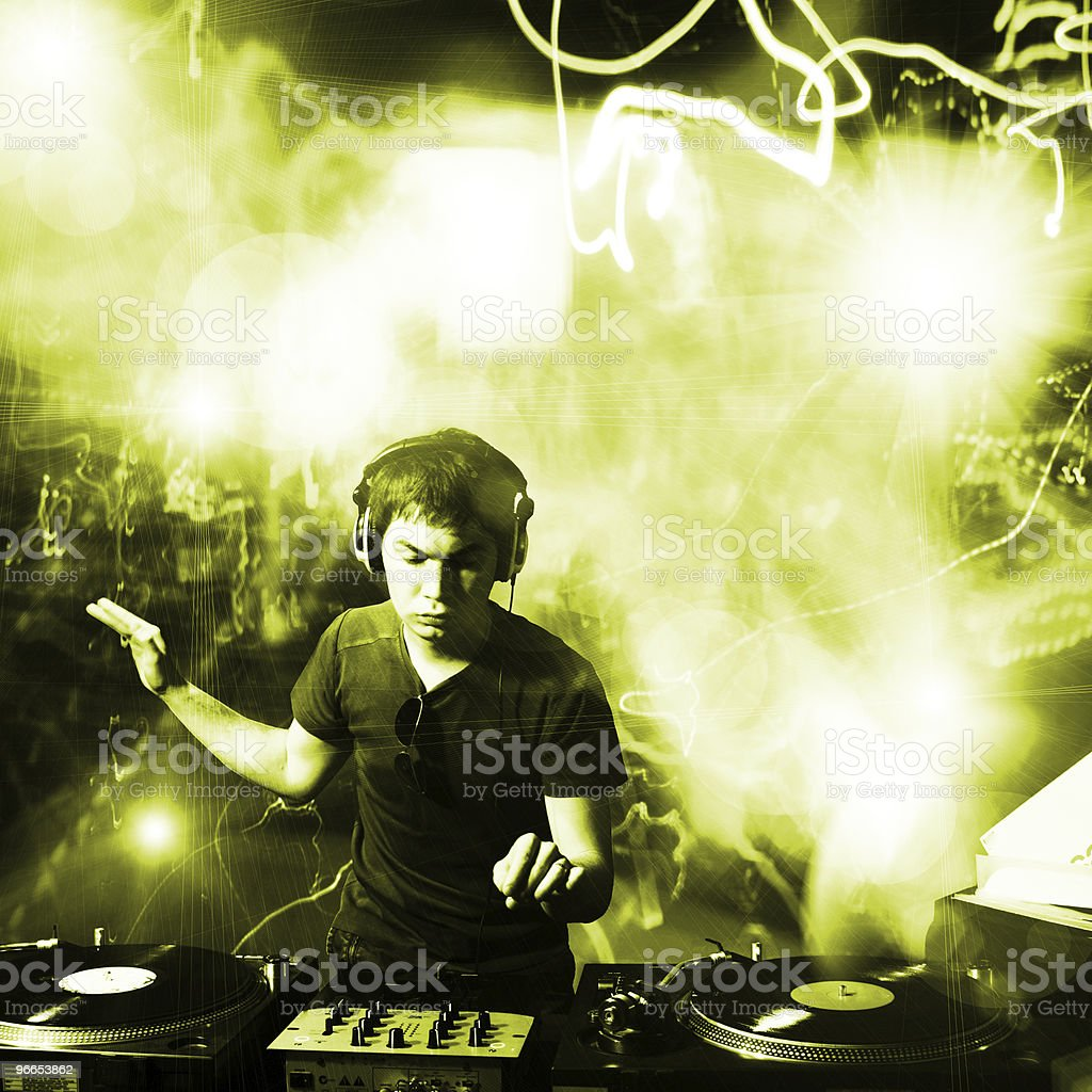 Disc jockey at concert with green lights royalty-free stock photo