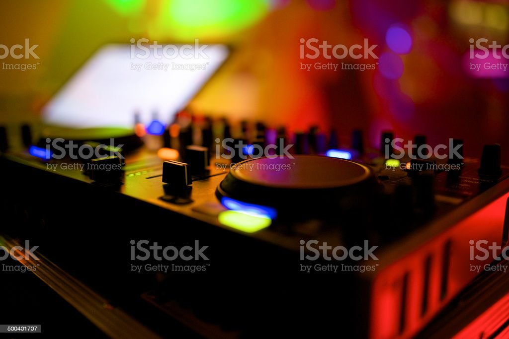 disc jockey at turntables before party background stock photo