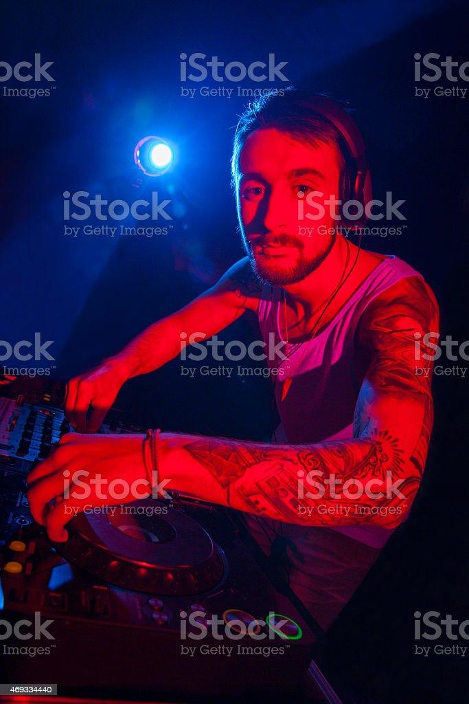 Disc jockey mixing music stock photo