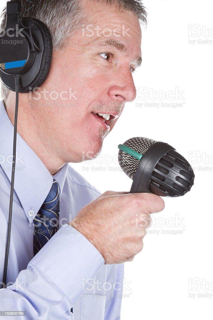 Disc Jockey with Headphones and Microphone stock photo