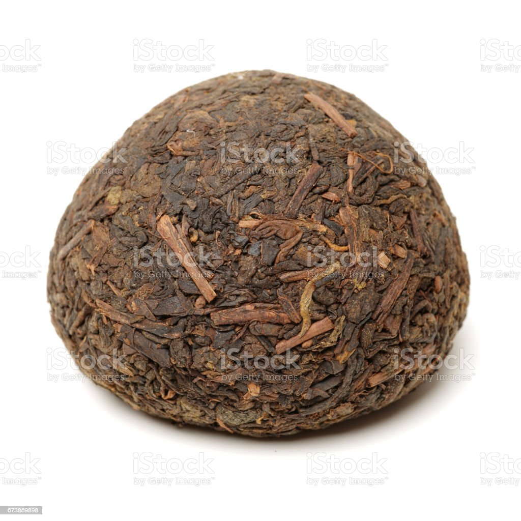 Disc Of Pu - Erh Tea  isolated on White Background stock photo