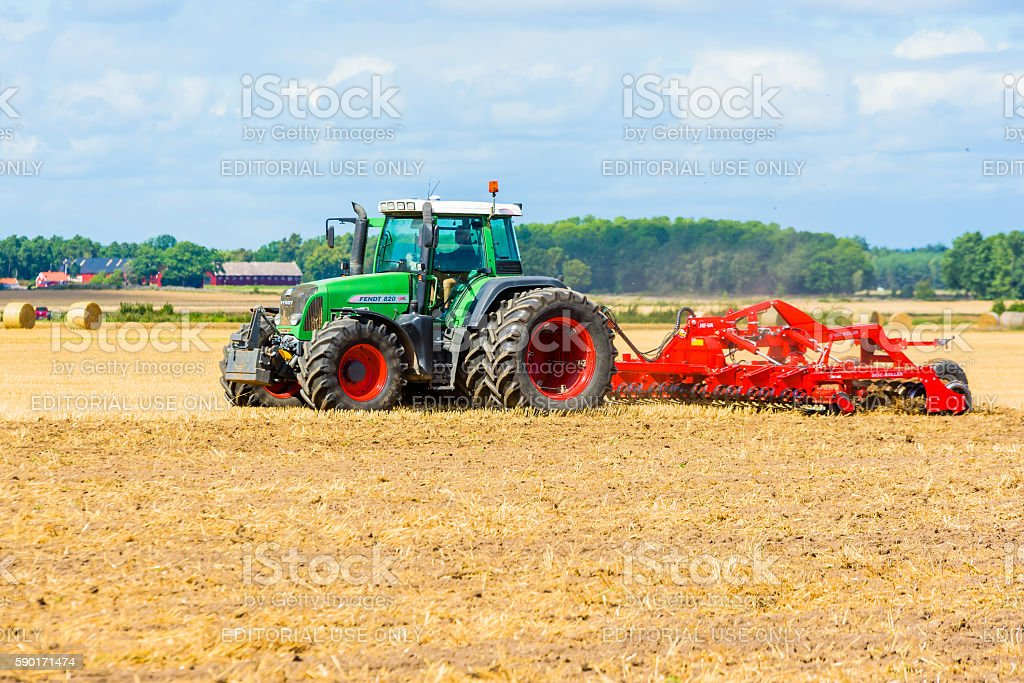 Disc rolling field stock photo