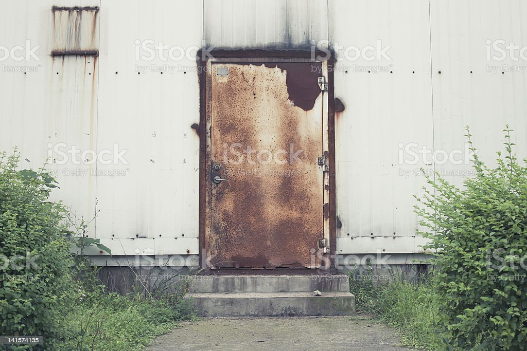 discard factory's door stock photo