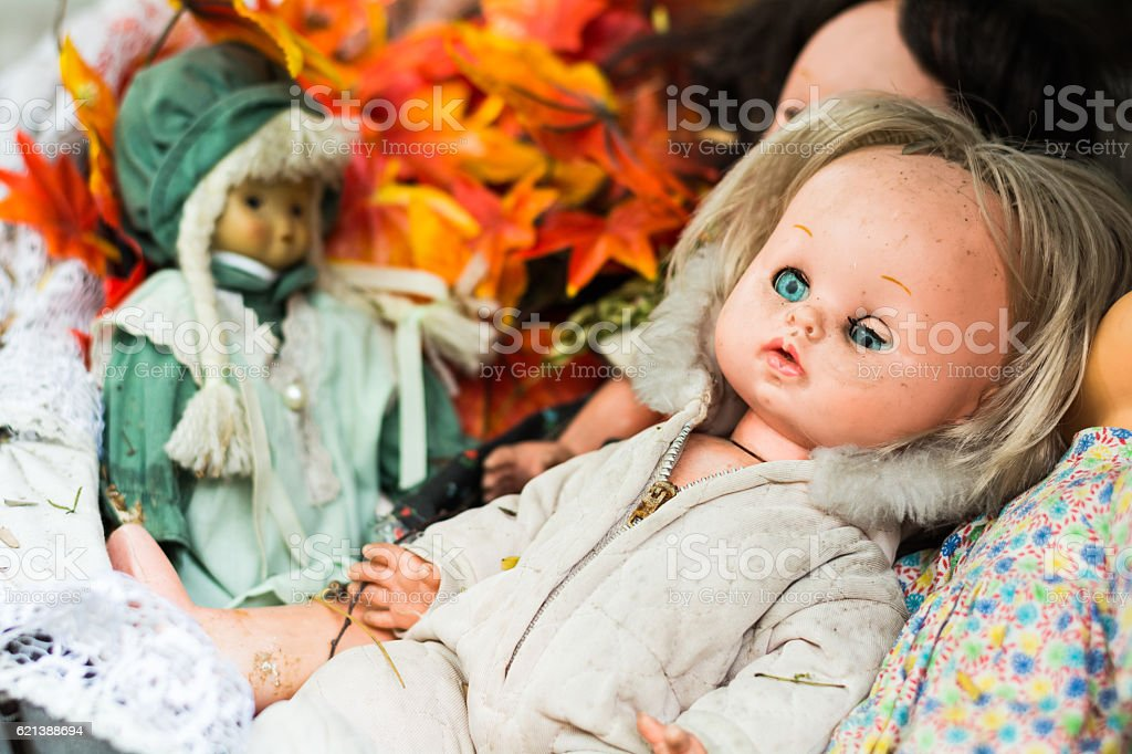 Discard old baby doll stock photo