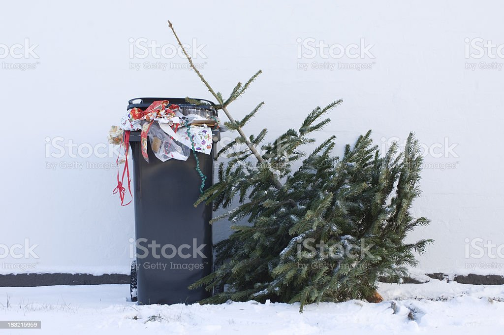Discarded Christmas Tree Waiting To Be Collected royalty-free stock photo