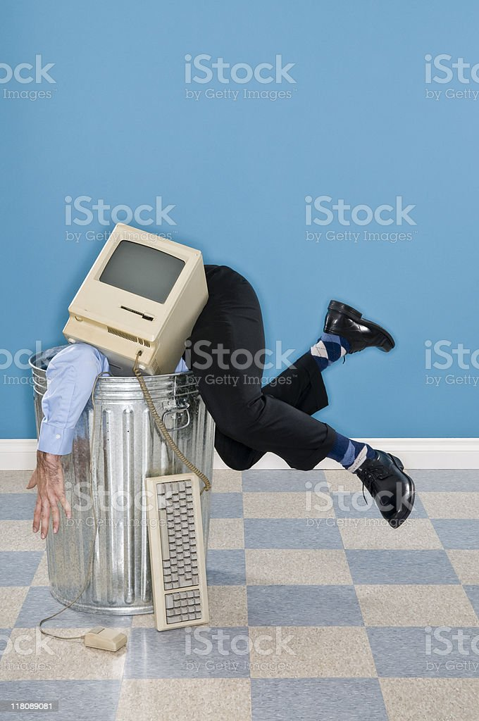 Discarded Corporate Executive And Old Computer In Trash Can royalty-free stock photo