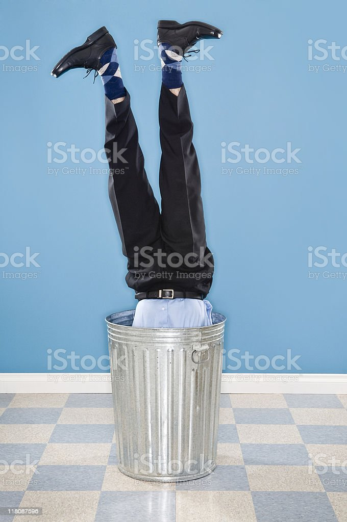 Discarded Corporate Executive In Trash Can royalty-free stock photo