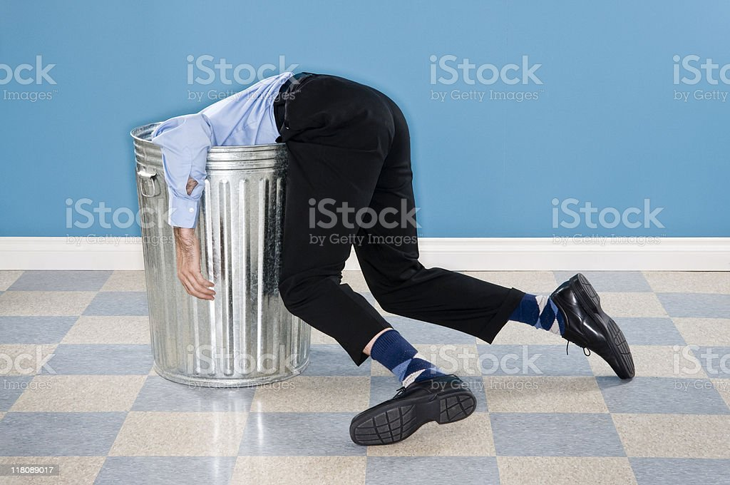 Discarded Corporate Executive In Trash Can stock photo