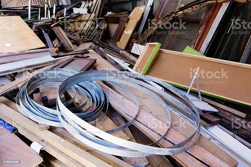 Discarded junk: debris of disused building materials stock photo