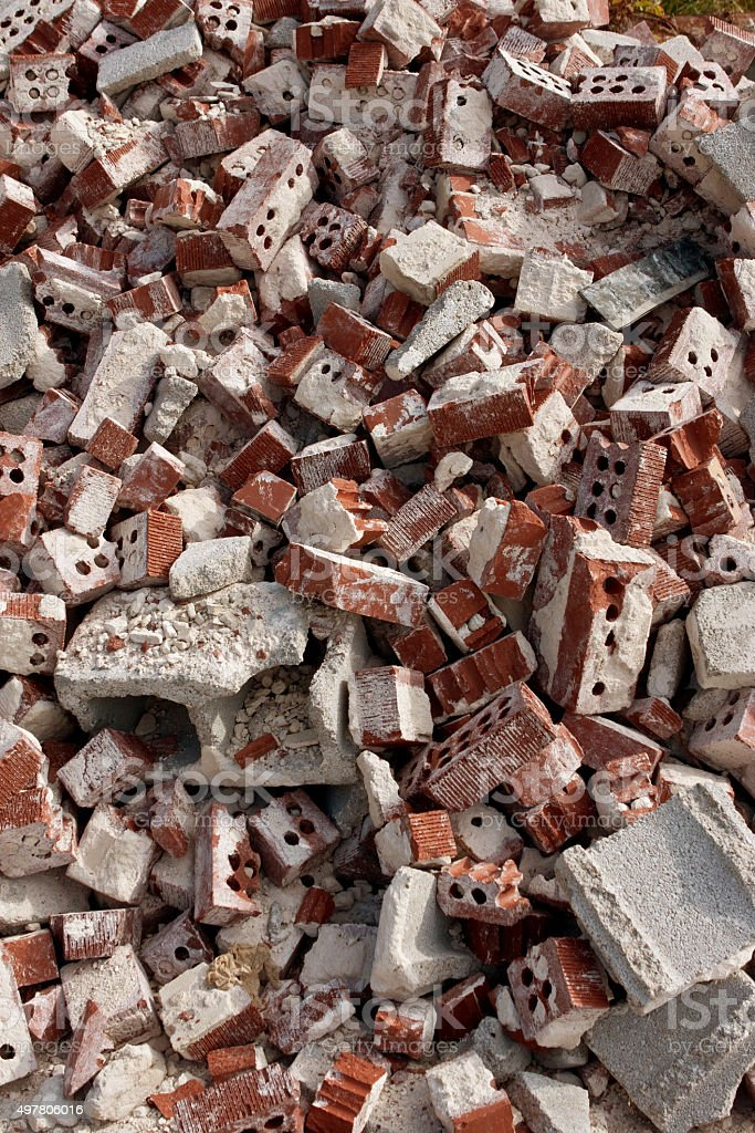 Discarded Red Bricks Are Piled High At Demolition Site stock photo