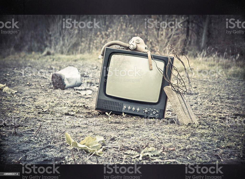 Discarded television set in the forest. ecological catastrophy stock photo