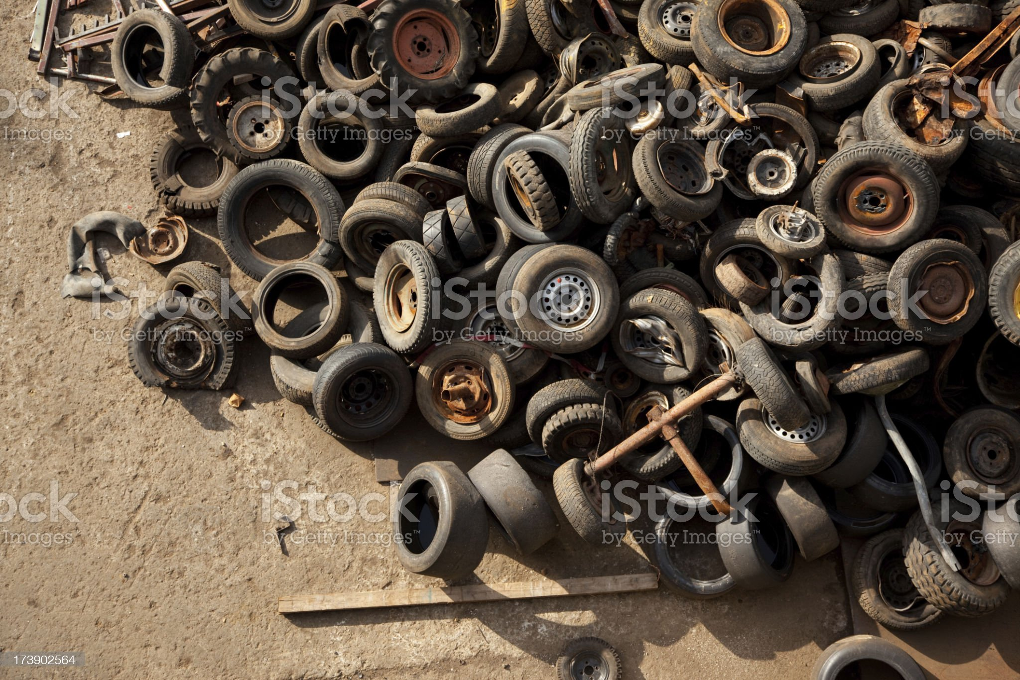 discarded tires in a scrap metal yard royalty-free stock photo