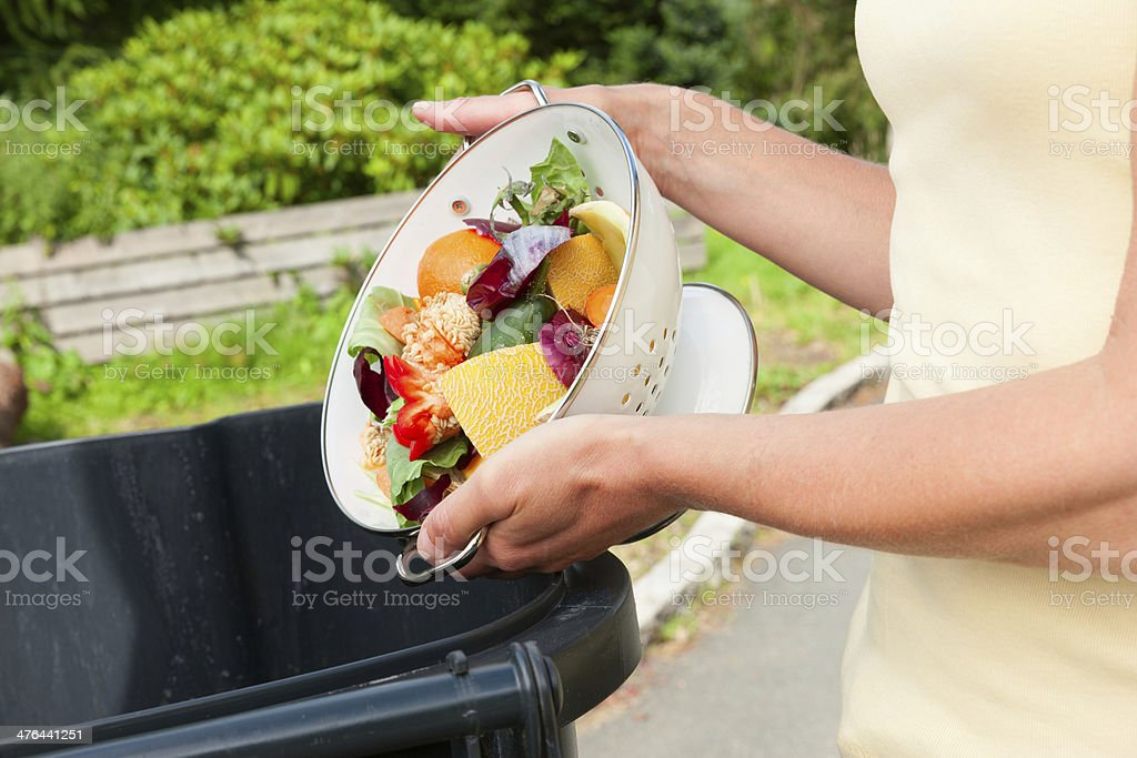 Discarding fruit and vegtable waste stock photo