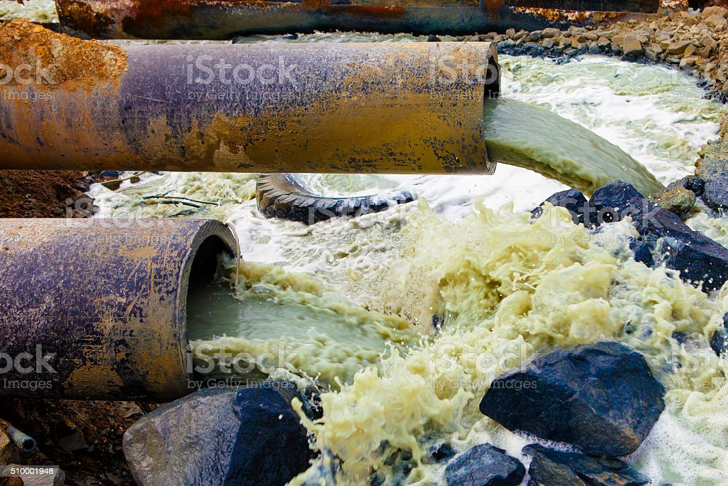 Discharge of liquid chemical waste. The danger for the environment. stock photo
