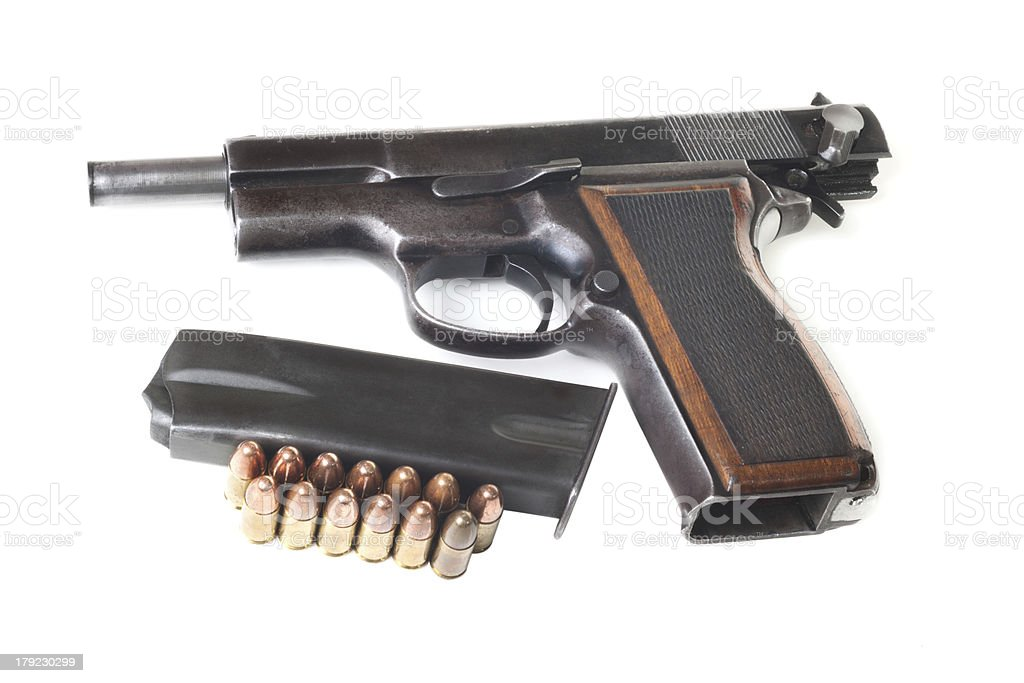 Discharged gun, holder and bullets stock photo