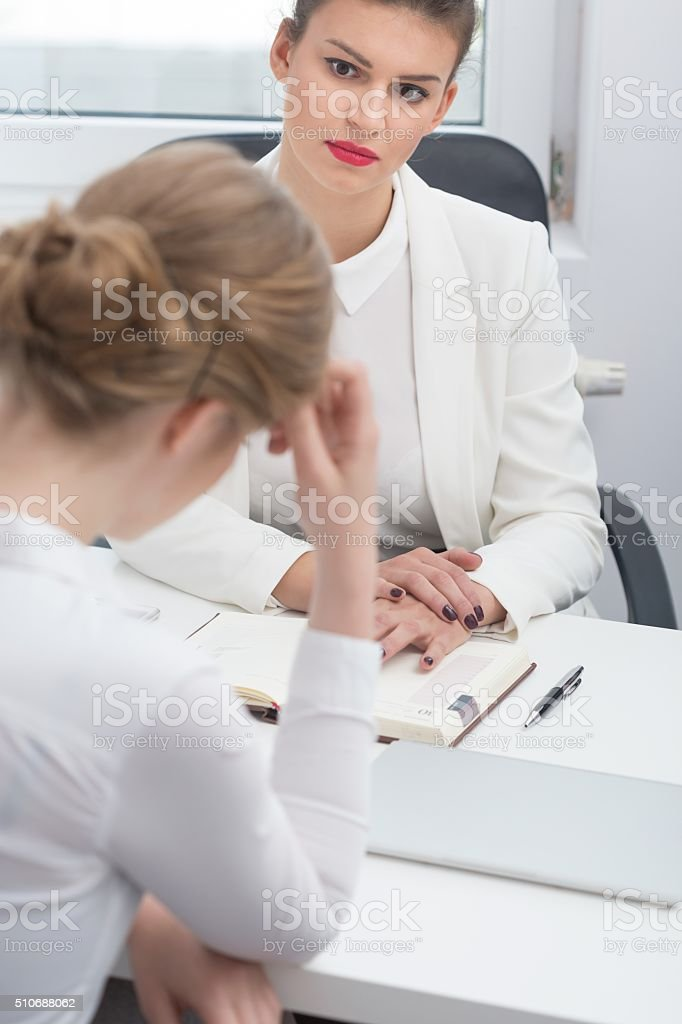 Disciplinary conversation with employee stock photo