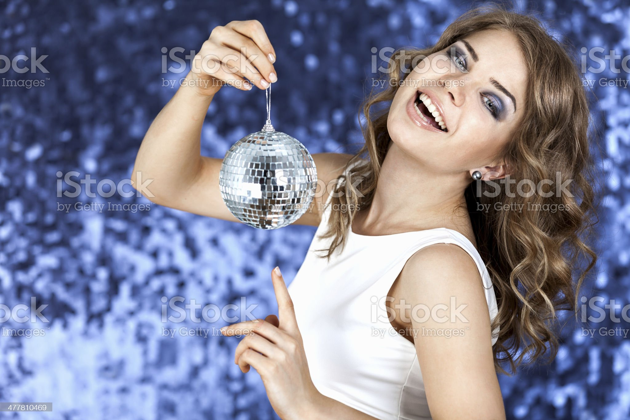disco ball and a curly blonde girl royalty-free stock photo