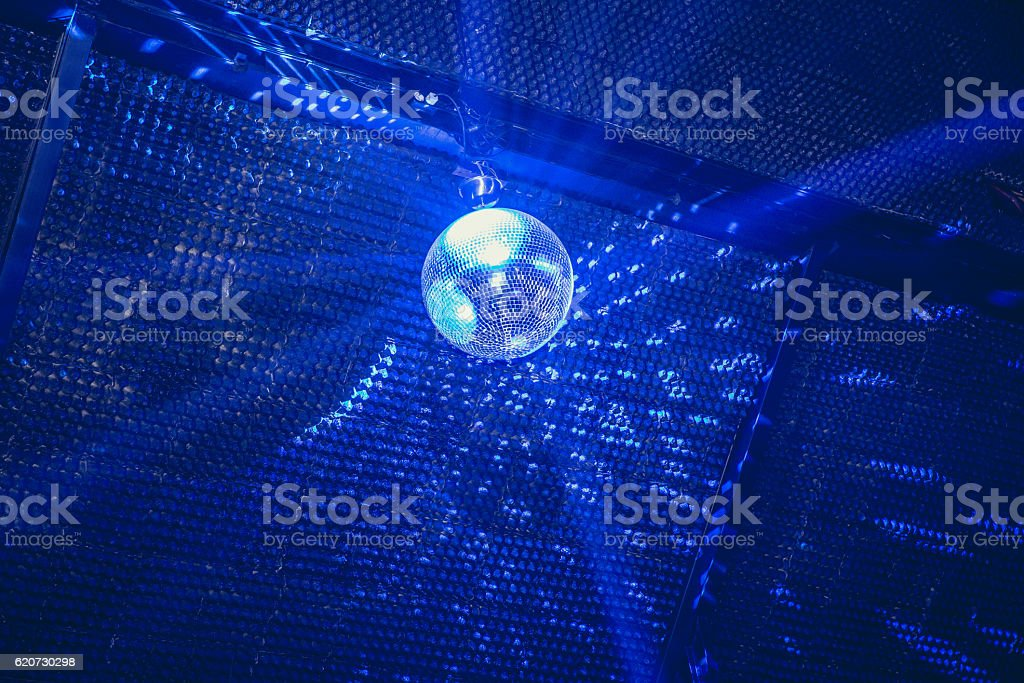 Disco ball in blue lights stock photo