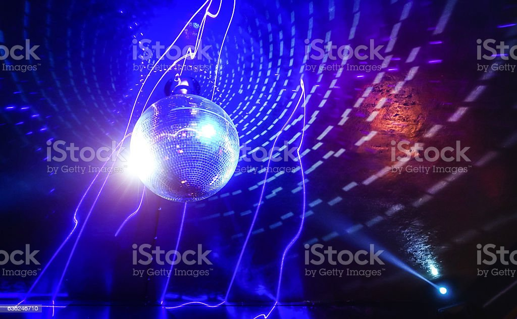 Disco ball laser show in modern disco party night club stock photo