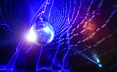 Disco ball laser show in modern disco party night club