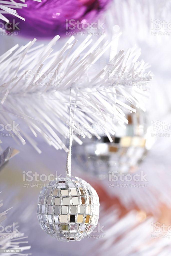 Disco ball on a white tree royalty-free stock photo