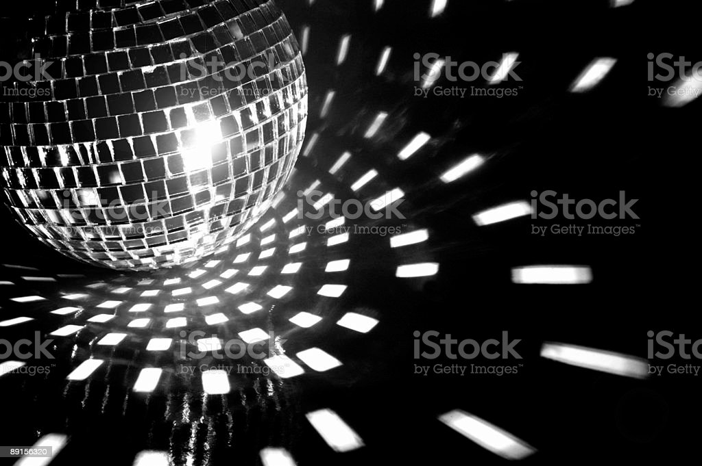 A disco ball relenting onto a club stock photo