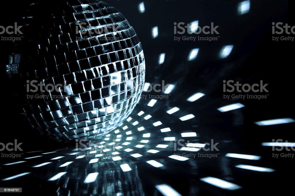 A disco ball sparkling in a dark room stock photo