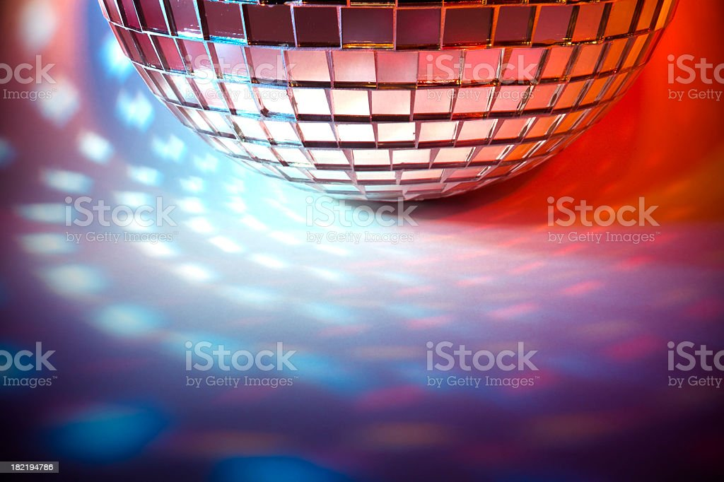 Disco ball with colored spot lights royalty-free stock photo