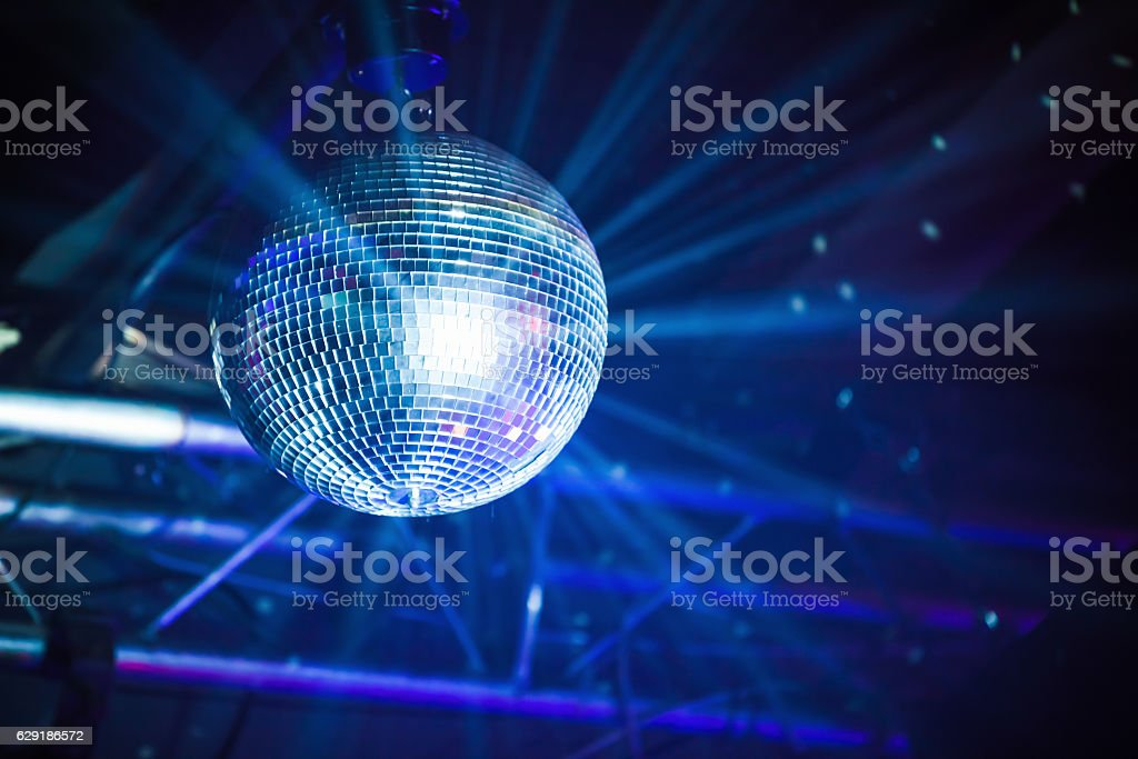 Disco ball with rays, party background stock photo