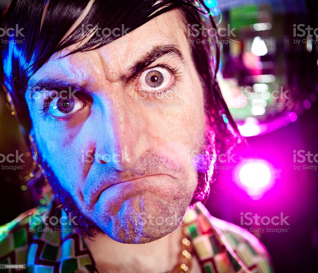 disco dance vintage man making a face at party stock photo