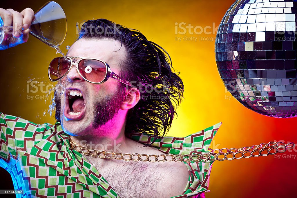 disco dancing vintage man throwing cocktail at party stock photo