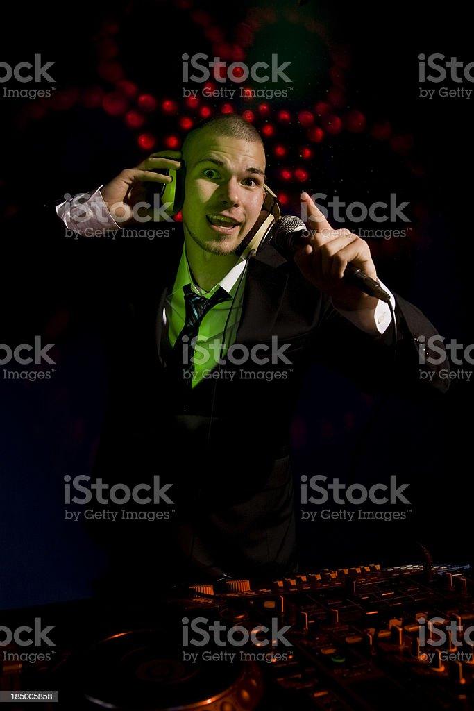 Disco DJ in action stock photo