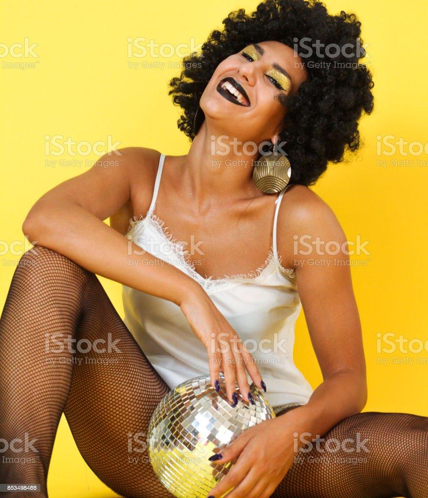 Disco girl, smilling with disco ball, sexy