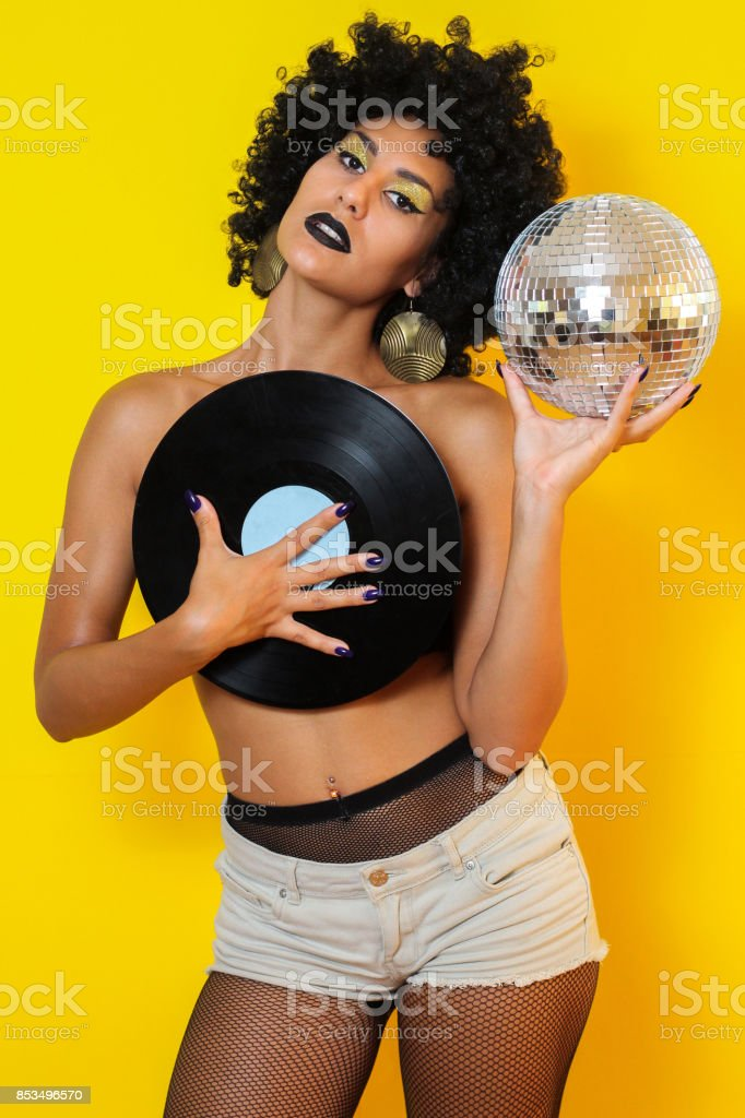 Naked girl with disco ball and record with afro hairstyle