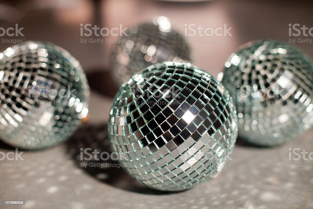 Disco mirror balls on surface stock photo