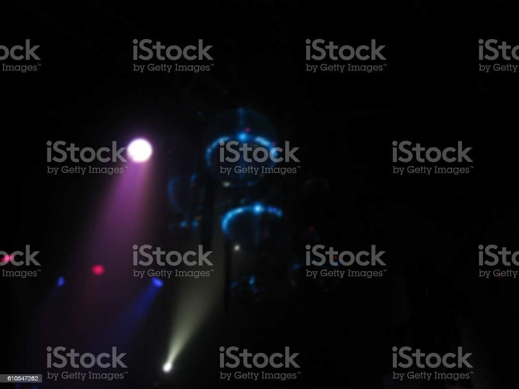 Disco party spotlights, disco ball and stage background. Blurry effect stock photo