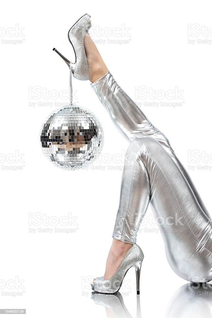 Disco time photo of disco ball hanging on silver high heels stock photo
