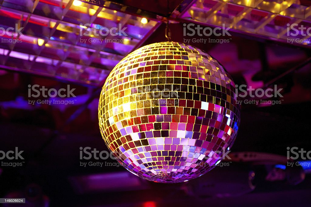 Discoball and spotlights on blurred background stock photo
