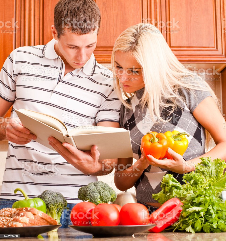 Discolored photo of a young couple starting to cook together royalty-free stock photo