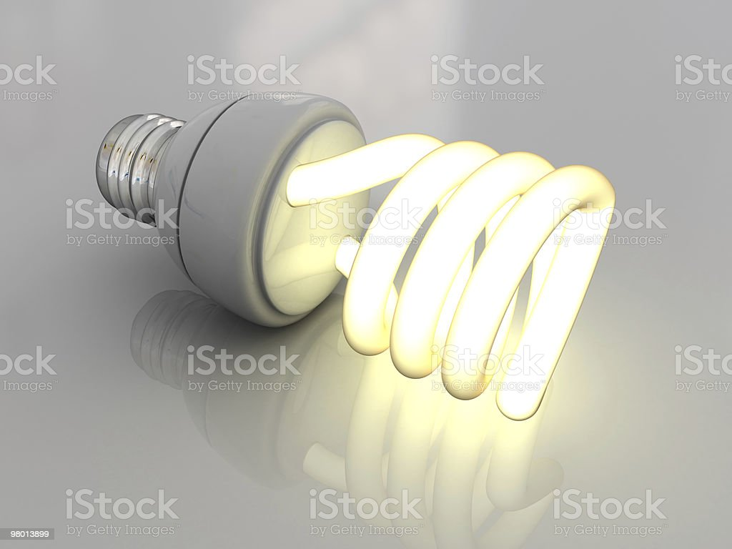 A disconnected compact fluorescent lightbulb is somehow lit royalty-free stock photo