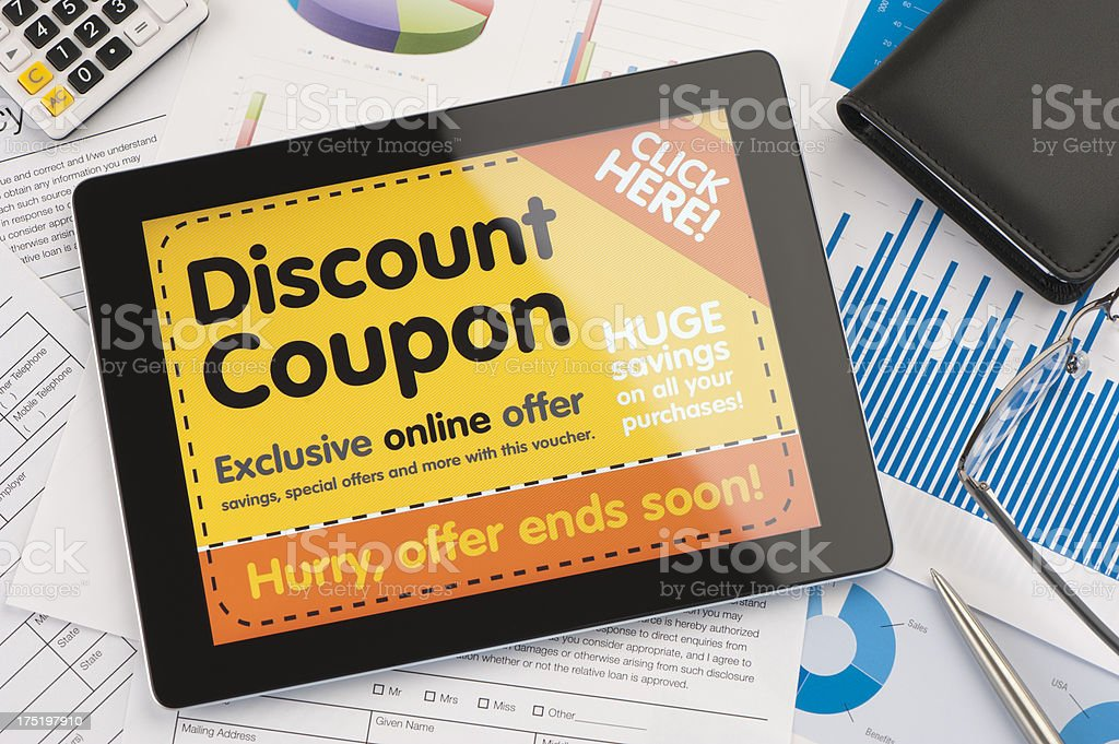 Discount coupon on a digital tablet stock photo