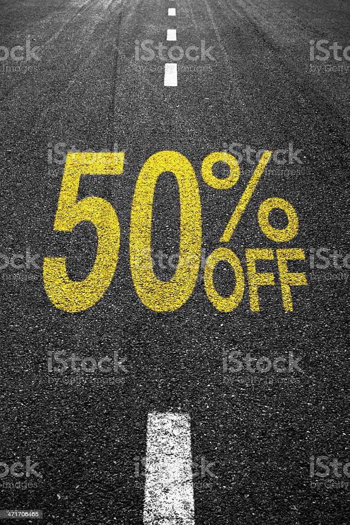 Discount sale sign on the asphalt royalty-free stock photo