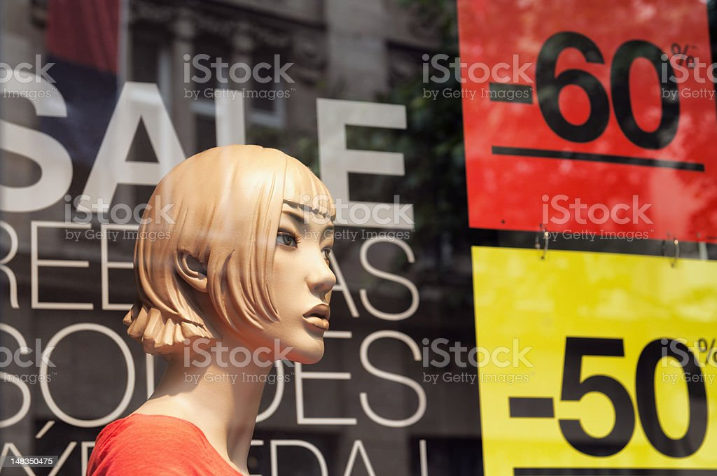 Discount signs in a shop window. royalty-free stock photo