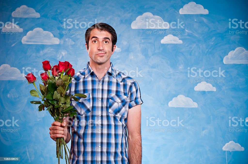 Discouraged Nerd With Roses stock photo