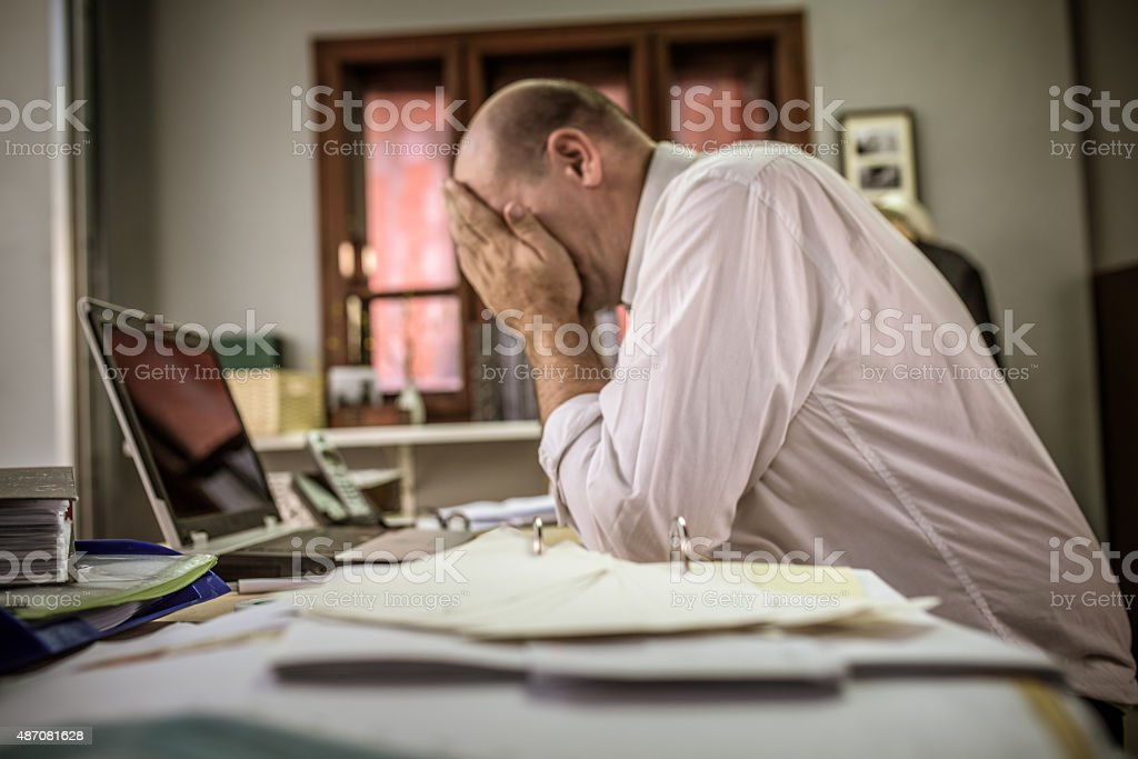 Discouraged office worker stock photo