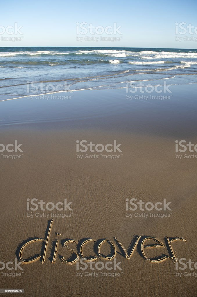Discover Message Handwritten on Empty Beach royalty-free stock photo