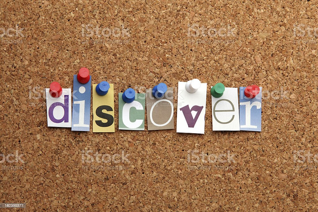 A 'discover' word pinned on noticeboard royalty-free stock photo