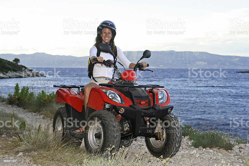 discovering island on atv royalty-free stock photo